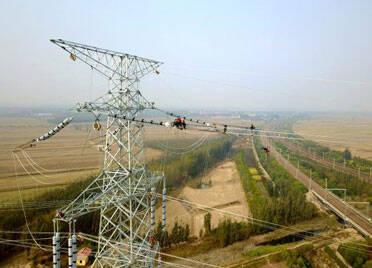 横空跨越一跨千米!山东官亭-潍坊特高压站500千伏线路工程跨越施工完成