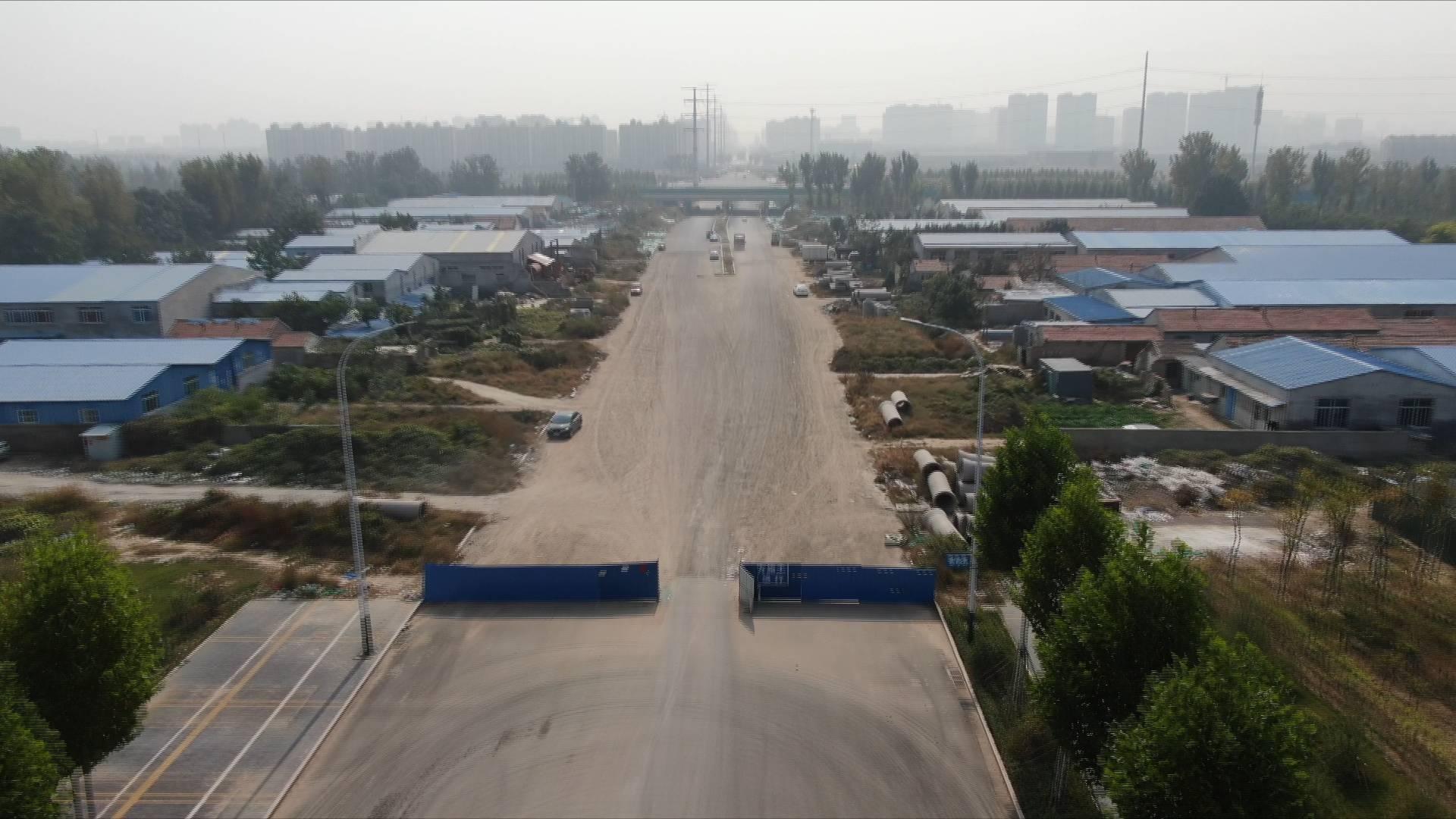 问政山东|因20多米没打通居民要绕行三五公里 潍坊这条道路施工现场变成垃圾场、停车场
