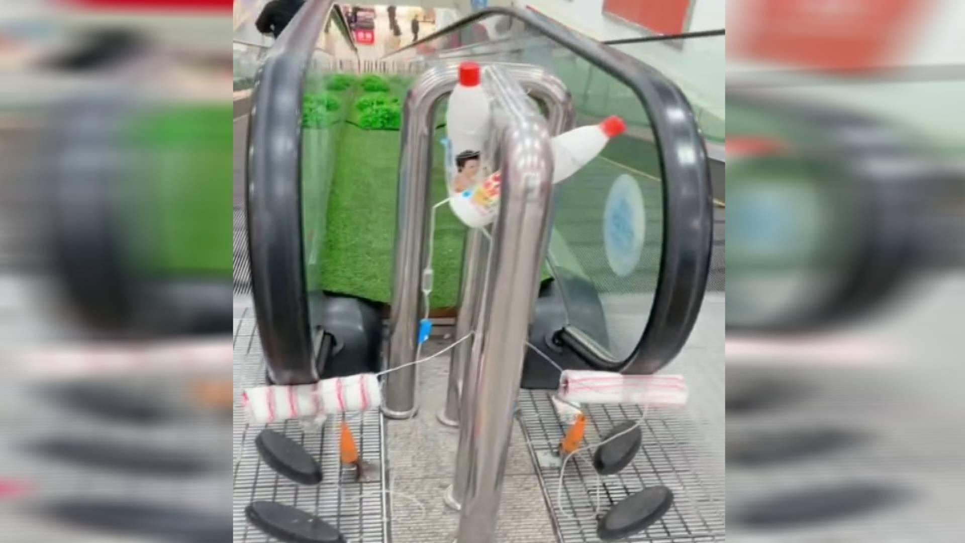 36秒|潍坊一超市给电梯输液?经理:给扶手消毒,一天用一筐刷子