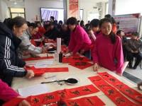 送福啦!济南邀请书画名家现场为农民工写春联