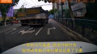 49秒|太疯狂!两辆大货车在青岛闹市区斗气飙车 已被交警查处